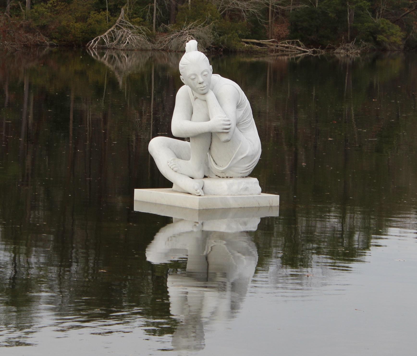 Altered pond statue